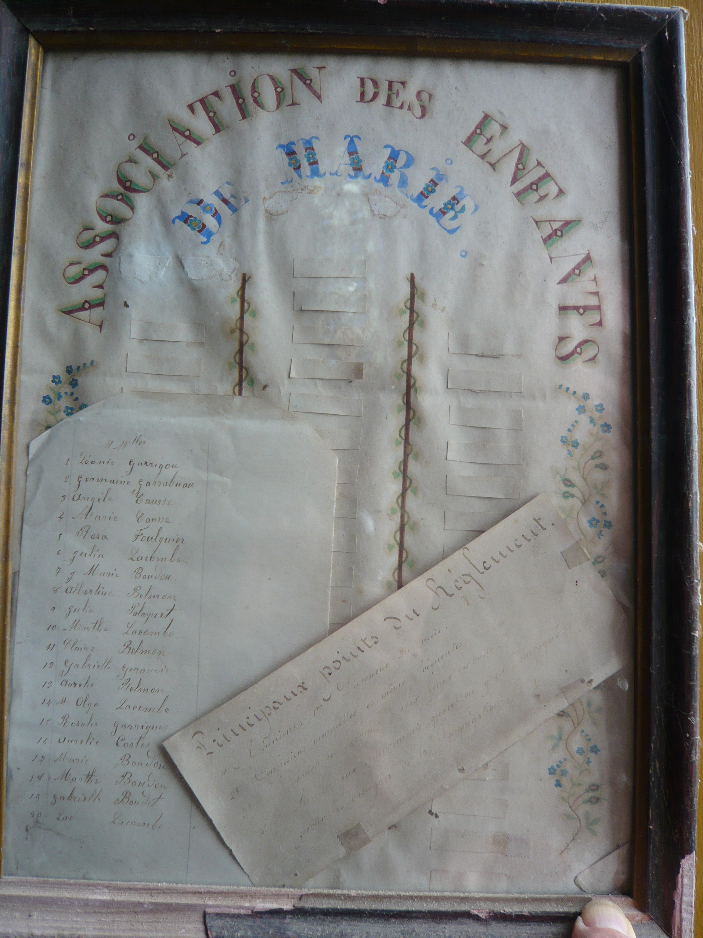 framed list of members Enfants de Marie